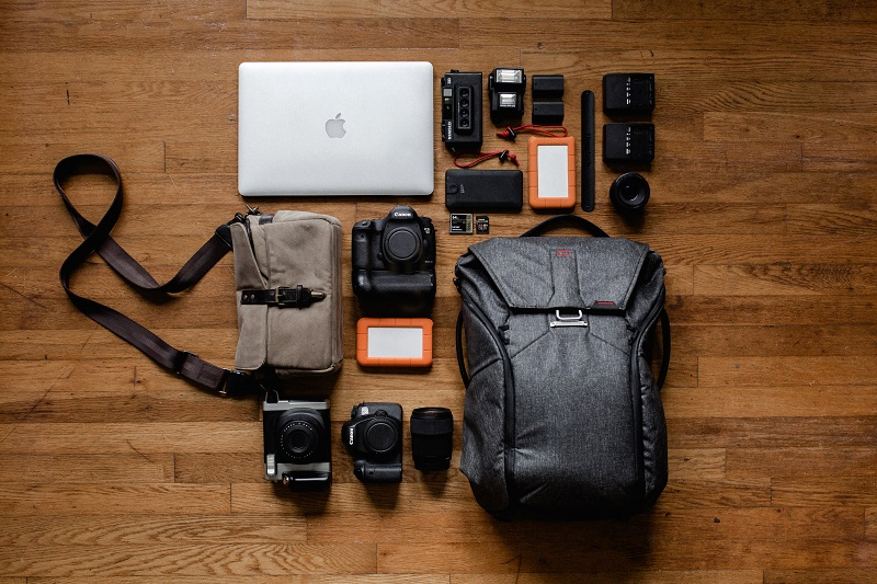 top-view-photo-of-laptop-near-camera-3178938 (1)